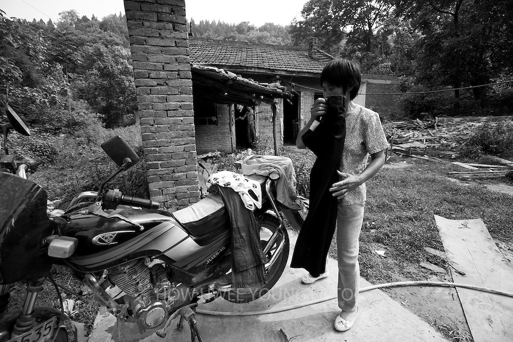 A villager of Cangfang town pack her belongings in preparations for relocation to neighbouring Hui county to make way for the colossal South-to-North Water Transfer project in Xichuan county of Henan Province in China on 28 June 2010. The South-to-North Water Transfer project, the largest known water diversion project, was conceived in 1952 to solve the country's chronic water shortages and involves creating three routes to channel 44.8 billion cu m of water from southern China to the northern areas. As part of the project's central route, affecting Henan and Hubei provinces, water from the Danjiangkou reservoir will be diverted to Beijing. The central route, which will raise the height of the Danjiangkou reservoir dam from 162 meters to 176.6 meters, requires the relocation of 330,000 people in Henan and Hubei provinces. Parts of Xichuan county, a remote, mountainous region inaccessible by railway and home to 162,000 migrants, the most anywhere, will be completely submerged by water from the Danjiangkou reservoir by 2014. The vast resettlement of affected residents in Xichuan county began in August 2009 and lasted till 2011.