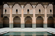 A tiles interior courtyard and reflecting pool at the Ben Youssef Madrassa, Marrakech, Morocco