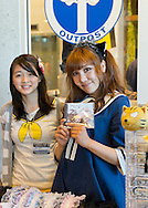 Garden City, New York, U.S. - June 14, 2014 - A vendor wearing cosplay outfit holds up a CD of Japanese singer Hitomi Himekawa music at Eternal Con, the annual Pop Culture Expo, held at the Cradle of Aviation Museum on Long Island.