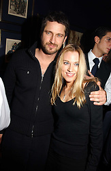 IMOGEN LLOYD WEBBER and GERALD BUTLER at a party hosted by Tatler magazine to celebrate the publication of the 2004 Little Black Book held at Tramp, 38 Jermyn Street, London SW1 on 10th November 2004.<br />