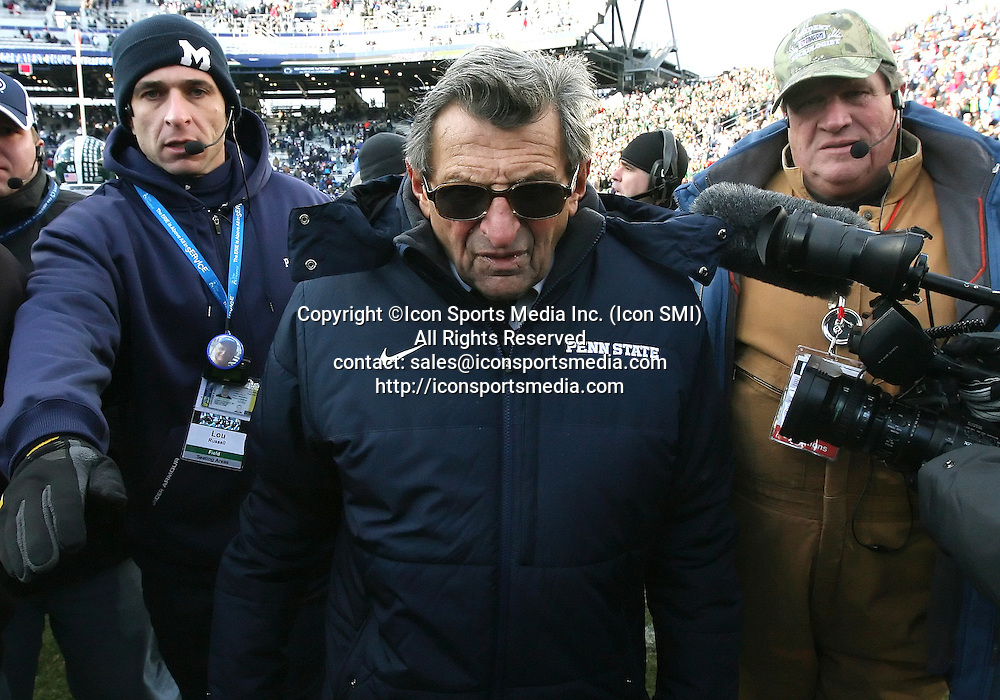 27 November 2010: Penn State head coach Joe Paterno leaves the field following a loss to Michigan State in a Big Ten Conference game at Beaver Stadium in University Park, PA.