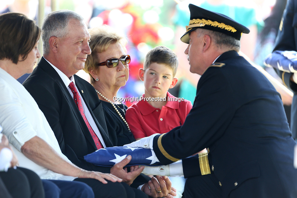 Eddie Thomas, father of the late Sergeant Kyle Thomas, receives the burial flag from the Mississippi National Gaurd Team Leader, during the graveside service for Thomas Friday afternoon in Amory.