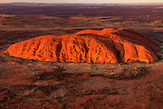 Uluru, Ayer's rock, aerial view at dawn,  Kata Tjuta National Park, Northern Territory, Australia