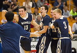 Magnolia players begin to celebrate winning the Class A championship game at the Charleston Civic Center.