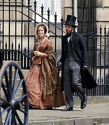 "Moray Place in Edinburgh's Georgian old town was turned into 19th century London for Julian Fellowes' new ITV show ""Belgravia"".<br /> <br /> Pictured: Extras chat between takes<br /> <br /> Alex Todd 