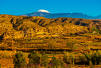 Badlands, with snowcapped La Sagra peak in background, near Galera, Granada Province, Andalusia, Spain.