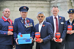 © Licensed to London News Pictures. 31/10/2017. London, UK.  (L to R) Andy Kent (TFL), Eric Reeve (TFL), Mayor of London, Sadiq Khan, Joe Hendry (Network Rail) and Sophia Hickinson (RAF) at the War Memorial outside Euston Station in support of the Royal British Legion's London Poppy Day campaign.  The annual London Poppy Day Appeal sees 2,500 service personnel, veterans and volunteers trying to raise GBP1m in a single day.  Photo credit: Stephen Chung/LNP