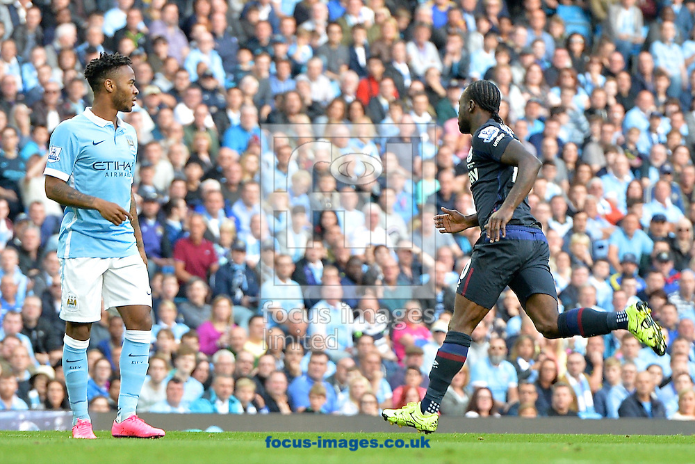 Raheem Sterling of Manchester City (left) looks on as Victor Moses of West Ham United celebrates scoring their first goal to make it Manchester City 0 West Ham United 1 during the Barclays Premier League match at the Etihad Stadium, Manchester<br /> Picture by Ian Wadkins/Focus Images Ltd +44 7877 568959<br /> 19/09/2015