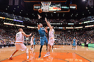 Jan 6, 2016; Phoenix, AZ, USA; Charlotte Hornets center Frank Kaminsky III (44) lays up the basketball against Phoenix Suns forward Mirza Teletovic (35) in the first half at Talking Stick Resort Arena. Mandatory Credit: Jennifer Stewart-USA TODAY Sports