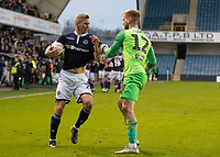 Football - 2018 / 2019 FA Cup - Third Round: Millwall vs. Hull City<br /> <br /> Steve Morison (Millwall FC) and George Long (Hull City) grapple as the Millwall player  keeps the ball after his team score what was the winning goal at The Den.<br /> <br /> COLORSPORT/DANIEL BEARHAM