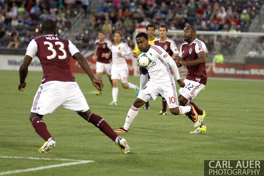 August 3rd, 2013 - Real Salt Lake forward Robbie Findley (10) attempts to bring the ball past Colorado Rapids defender Marvell Wynne (22) and defender German Mera (33) in the first half of the Major League Soccer match between Real Salt Lake and the Colorado Rapids at Dick's Sporting Goods Park in Commerce City, CO