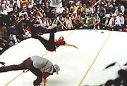 Crowd watching a two B-boys pullin' some moves on stage, Japan, 2003