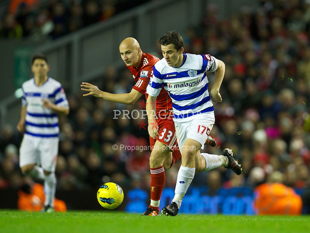 LIVERPOOL, ENGLAND - Saturday, December 10, 2011: Liverpool's Jonjo Shelvey in action against Queens Park Rangers' Joey Barton during the Premiership match at Anfield. (Pic by David Rawcliffe/Propaganda)