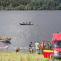 Divers from Police Scotland and firefighters from the Scottish Fire & Rescue Service search Loch Tay south of Killin for the body of a 29 year old canoeist missing after his boat capsized on Saturday evening....06.07.14<br /> Picture by Graeme Hart.<br /> Copyright Perthshire Picture Agency<br /> Tel: 01738 623350  Mobile: 07990 594431