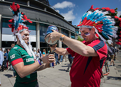 © Licensed to London News Pictures. 27/05/2017. London, UK. Rugby fans pour themselves a beer outside Twickenham stadium ahead of the Aviva Premiership Rugby Final. Security has been increased at venues across the UK, with the military called in to help police, following a terrorist attack at a music concert in Manchester on Monday evening. Photo credit: Peter Macdiarmid/LNP