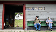 Train volunteers Robert Gehringer, left, and Bill Nolan sit on a bench outside of the Wentworth Depot after taking a group on a train ride back in June. (Matt Gade/Republic)
