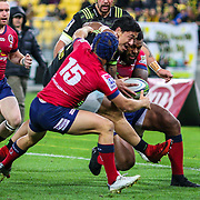 Ben Lam  tackled during the Super rugby union game (Round 14) played between Hurricanes v Reds, on 18 May 2018, at Westpac Stadium, Wellington, New  Zealand.    Hurricanes won 38-34.