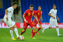 Gareth Bale of Wales (Real Madrid) chases down Dusan Tadic of Serbia (FC Twente ) during the second half of the match - Photo mandatory by-line: Rogan Thomson/JMP - Tel: Mobile: 07966 386802 10/09/2013 - SPORT - FOOTBALL - Cardiff City Stadium - Cardiff -  Wales V Serbia- World Cup Qualifier.