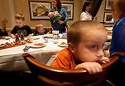 Carter Davdison, left, plays with digital devices while fellow child on the autism spectrum Hagen Dickinson, right looks on during lunch at BRIO Tuscan Grill in Murray, Friday, Nov. 9, 2012.