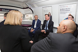 © Licensed to London News Pictures. 23/06/2015. London, UK. DAVID CAMERON speaking to entrepreneurs on the bus at the launch of the Start-Up Britain campaign routemaster bus in Downing Street, London with Prime Minister, David Cameron. Over five weeks the routemaster bus will visit 30 towns and cities - including Aberdeen, Inverness, Swansea York and Leeds - and aim to engage with 15,000 individuals through workshops and networking events, making them aware of the assistance Start-Up Britain can offer. Photo credit : Vickie Flores/LNP