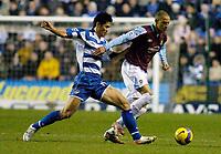 Photo: Gareth Davies.<br />Reading v West Ham United. The Barclays Premiership. 01/01/2007.<br />Reading's Seol Ki-Hyeon (L) challenges with West Ham's Bobby Zamora (R).