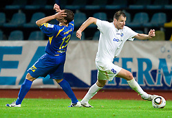 Ivan Knezovic of Domzale and Dragan Cadikovski of Celje  during the football match between NK Domzale and MIK CM Celje, played in the 10th Round of Prva liga football league 2010 - 2011, on September 22, 2010, Spors park, Domzale, Slovenia. Domzale defeated Celje 1 - 0. (Photo by Vid Ponikvar / Sportida)