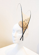 Holly Gaiman - Milliner - final collection of hats and headpieces, elegance inspired by calligraphy, on display at Kensington and Chelsea College, London, Great Britain. <br /> <br /> Private view on 7th June 2011.