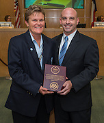 Marmion Dambrino, left, and Ben Rose, right, pose for a photograph during a meeting of the Houston ISD Board of Trustees meeting, September 11, 2014.