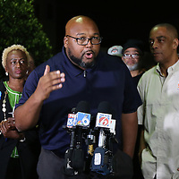 Bishop Kelvin Cobaris speaks during a vigil to honor deceased Orlando Police officer Master Sgt. Debra Clayton who was shot and killed as she attempted to stop and question accused gunman Markeith Loyd, at an Orlando Walmart, on January 10, 2017 in Orlando, Florida. Orange County deputy Norm Lewis who was also killed on his motor patrol while responding to Clayton's shooting was also honored.  (Alex Menendez via AP)