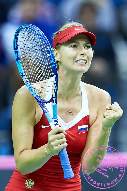 Maria Sharapova from Russia celebrates winning point and match during First Day of the Fed Cup / World Group 1st round tennis match between Poland and Russia at Tauron Krakow Arena on February 7, 2015 in Cracow, Poland.<br /> <br /> Poland, Cracow, February 7, 2015<br /> <br /> Picture also available in RAW (NEF) or TIFF format on special request.<br /> <br /> For editorial use only. Any commercial or promotional use requires permission.<br /> <br /> Adam Nurkiewicz declares that he has no rights to the image of people at the photographs of his authorship.<br /> <br /> Mandatory credit:<br /> Photo by &copy; Adam Nurkiewicz / Mediasport