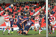 Blackpool defender Tom Aldred (15)  clears the danger with his head during the Sky Bet League 1 match between Doncaster Rovers and Blackpool at the Keepmoat Stadium, Doncaster, England on 28 March 2016. Photo by Simon Davies.