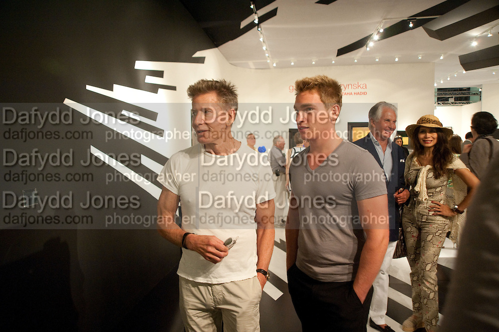 CALVIN KLEIN; NICHOLAS GRUBER; GEORGE HAMILTON; CASSANDRA CAVA, Opening of Art Basel Miami Beach. Convention Centre.  Miami Beach. 30 November 2010. -DO NOT ARCHIVE-© Copyright Photograph by Dafydd Jones. 248 Clapham Rd. London SW9 0PZ. Tel 0207 820 0771. www.dafjones.com.