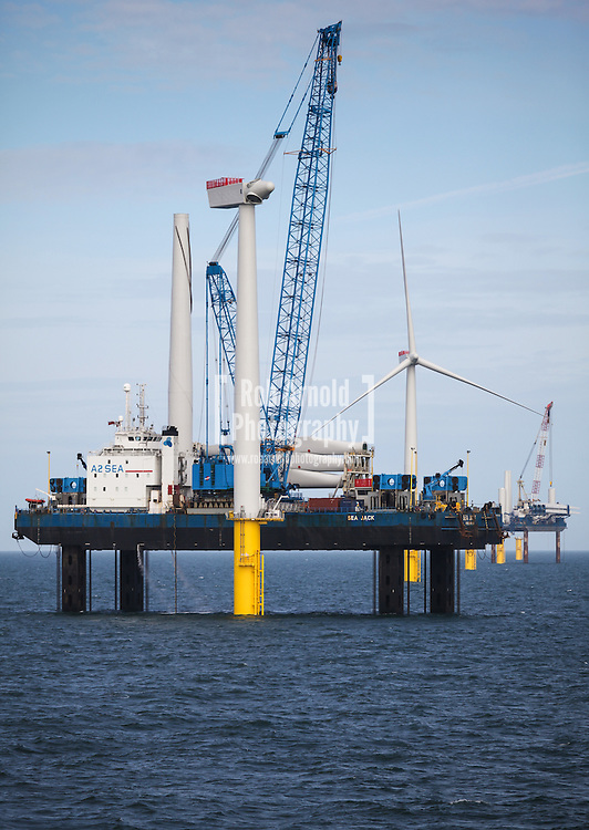 Sea Jack (foreground) and Sea Worker (backgroud) installing a turbine on Gwynt y Mor Offshore Wind Farm off the coast of North Wales.
