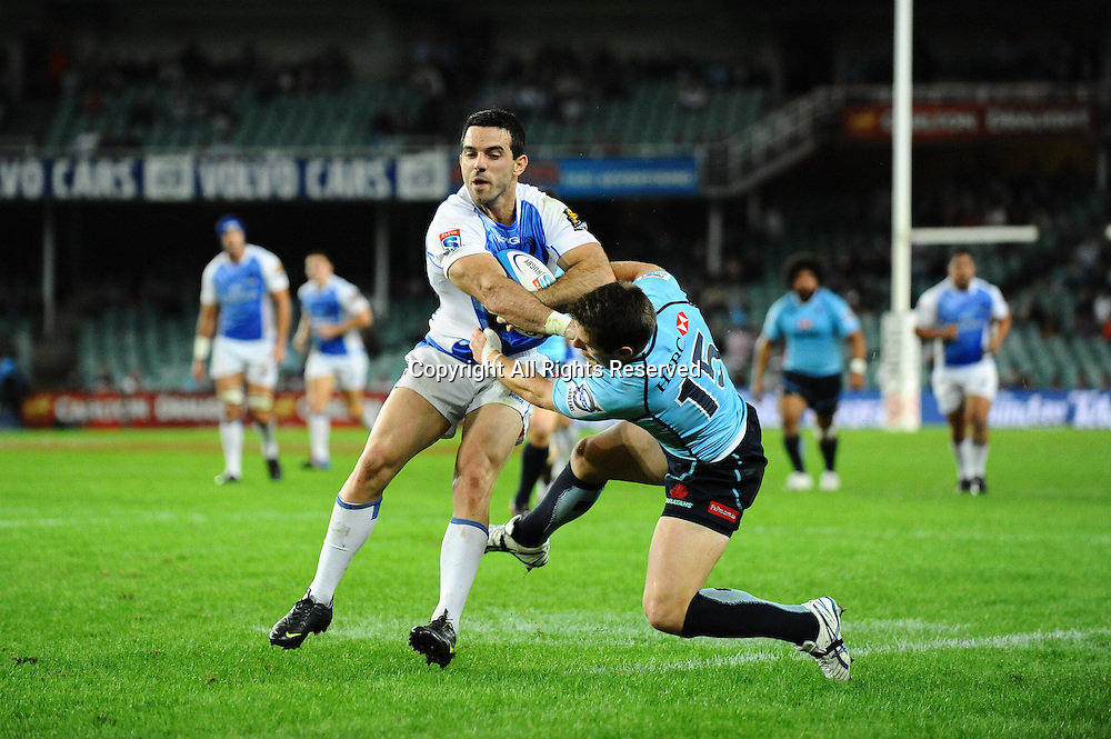 17.03.2012 Sydney, Australia. Force fullback David Harvey is tackled by Waratahs fullback Bernard Foley during the FxPro Super Rugby game between the New South Wales Waratahs  and Western Force at the Allianz Stadium,Sydney.