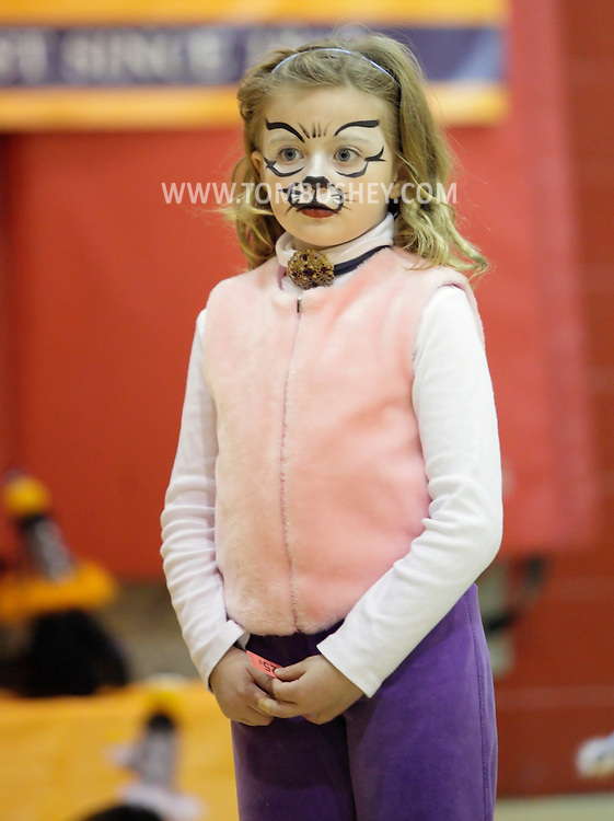 Middletown, New York  - A girl in a cat costume waits to play a game in the gymnasium during the Middletown YMCA Family Fall Festival on Oct. 29, 2011. ©Tom Bushey / The Image Works