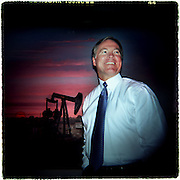 07/01/03 -- DIGITAL -- #50802  Scott Heape, founder and president of H&S Production Inc., stands near a oil drilling mural in his boardroom..  Heape is one of the few remaining Texas wildcatters to survive three decades of boom and bust.  07042003xBIZ