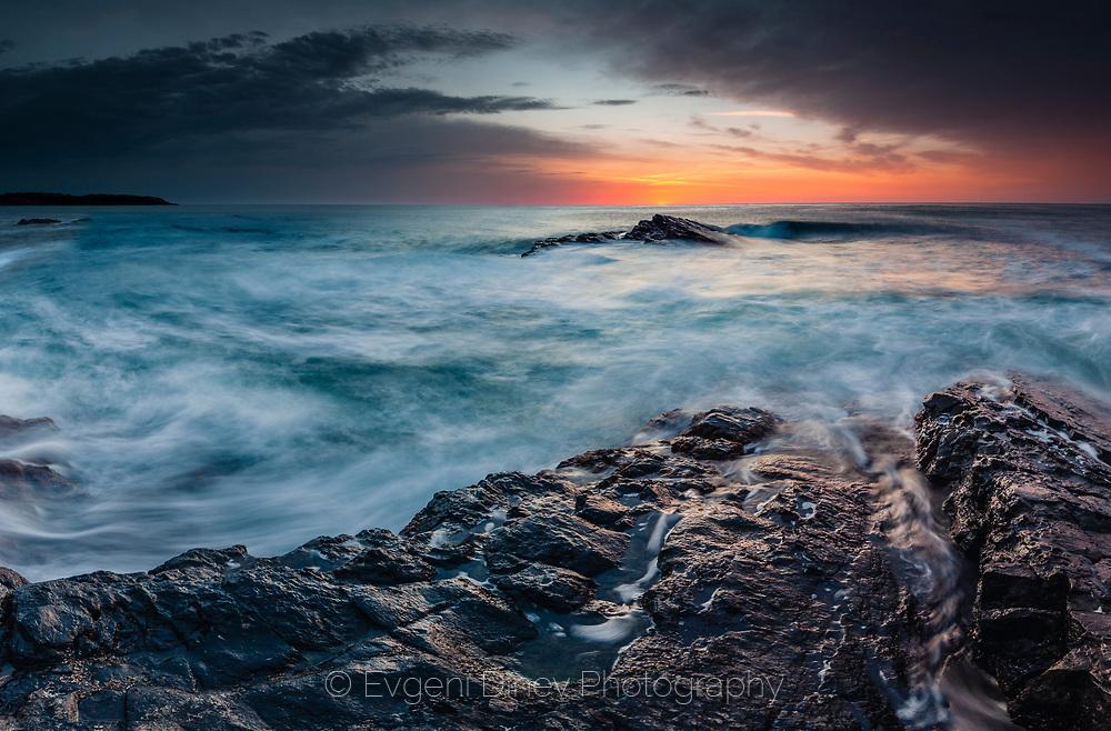 Wavy sea at sunrise