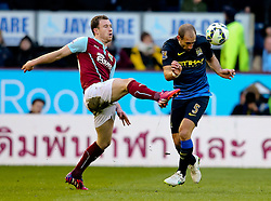 Manchester City's Pablo Zabaleta heads the ball under pressure from Burnley's Ashley Barnes  - Photo mandatory by-line: Matt McNulty/JMP - Mobile: 07966 386802 - 14/03/2015 - SPORT - Football - Burnley - Turf Moor - Burnley v Manchester City - Barclays Premier League