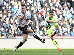 Nahki Wells of Huddersfield Town (R) has a shot at goal - Mandatory byline: Jack Phillips/JMP - 05/03/2016 - FOOTBALL - iPro Stadium - Derby, England - Derby County v Huddersfield Town - Sky Bet Championship