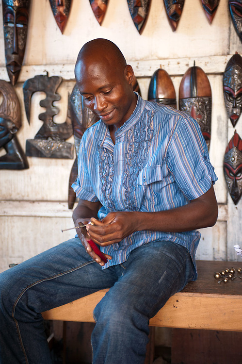 Seller of wooden masks at the Centre For National Culture, Accra, Ghana 2011