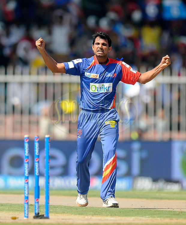 Mohammad Shami of the Delhi Daredevils celebrates after getting Rohit Sharma captain of of the Mumbai Indians run out during match 16 of the Pepsi Indian Premier League 2014 between the Delhi Daredevils and the Mumbai Indians held at the Sharjah Cricket Stadium, Sharjah, United Arab Emirates on the 27th April 2014<br /> <br /> Photo by Pal Pillai / IPL / SPORTZPICS