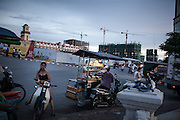 A busy street junction in Diamond Island, the brand new commercial and residential area in Phnom Penh. Most of the hydroelectric projects planned along the Mekong river seem to be necessary for the power demand from the rising metropolis around south-east asia. The LSS2 dam could potentially generate a fifth of the power Cambodia is likely to need by 2018 but the effects on the environment are devastating.