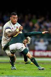 Faf de Klerk of South Africa looks to make a tackle on Nathan Hughes of England- Mandatory by-line: Steve Haag/JMP - 23/06/2018 - RUGBY - DHL Newlands Stadium - Cape Town, South Africa - South Africa v England 3rd Test Match, South Africa Tour