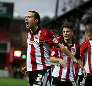 Brentford striker Lasse Vibe scoring the first goal during the Sky Bet Championship match between Brentford and Milton Keynes Dons at Griffin Park, London, England on 5 December 2015. Photo by Matthew Redman.