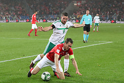 Switzerland's Stephan Lichtsteiner (left) and Northern Ireland's Conor Washington battle for the ball during the FIFA World Cup Qualifying second leg match at St Jakob Park, Basel.
