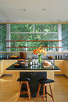 Retro styled kitchen with black worktop and kitchen island