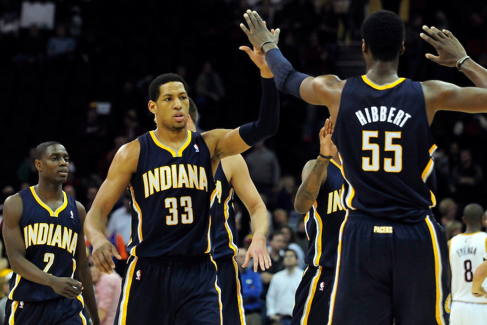 Feb. 2, 2011; Cleveland, OH, USA; Indiana Pacers small forward Danny Granger (33) celebrates with center Roy Hibbert (55) during the  final minute of the fourth quarter against the Cleveland Cavaliers at Quicken Loans Arena. The Pacers beat the Cavaliers 117-112. Mandatory Credit: Jason Miller-US PRESSWIRE