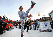 Evan Padua of the Mangy Moose team lifts his leg to catch the next mug flying at the Gelande Quaffing World Championships on Wednesday in Teton Village. The annual drinking competition challenges teams to slide full beers down a slippery bar, where hopefully a teammate will catch and then quaff the brew as fast as possible.
