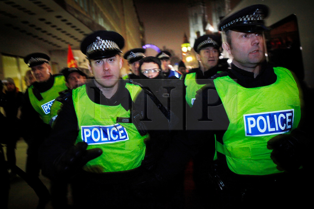 © under license to London News Pictures. The police move an arrested protestor to the police van after scuffles break out at the Save EMA (Educational Maintenance Allowance) protest in Victoria St, London outside the Department for Innovation and Skills (13/12/10) Photo credit should read: Olivia Harris/ London News Pictures