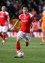 London, England - Saturday, January 12th, 2008:  Charlton Athletic's Zheng Zhi in action against Blackpool during the League Championship match at The Valley. (Pic by Chris Ratcliffe/Propaganda)